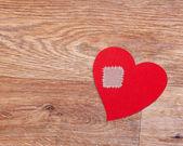 Broken heart on wooden floor with copy space — Stock Photo