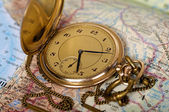 Old watch on map — Stock Photo