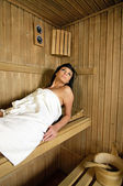 Young Woman in sauna — Stock Photo