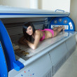 Stock Photo: Young Womin Solarium