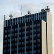 Rooftop of building with communications antennas - Photo