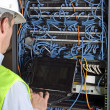 Stock Photo: Server and wires during check-up