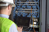 Server and wires during check-up — Stock Photo