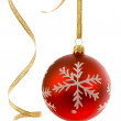 Red bauble and curly ribbon — Stock Photo