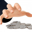 Hand reaching for coins — Stock Photo #4305220