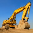 Huge excavator in front of cloudless sky - Stock Photo