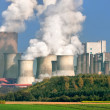 Large power plant on a sunny day - Stock Photo