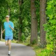 Young man running in a beautiful park — Stock Photo