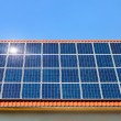 Solar panel on a roof under the cloudless sky - Stock Photo
