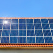 Solar panel on roof under cloudless sky — Stock Photo #4305477