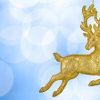 Christmas bokeh background with golden reindeer — Stock Photo #4305520