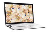 Geld auf dem laptop-display — Stockfoto