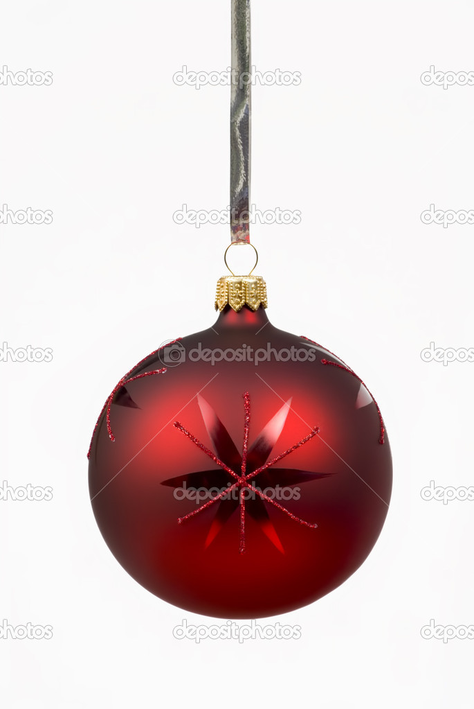 Single red Christmas ball hanging in front of white background  Stock Photo #4303993