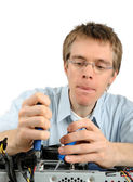 Young technician repairing a PC — Stock Photo