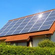 Solar panel on a red roof - Foto Stock