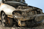 Burnt down car — Stock Photo