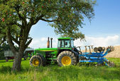 Tractor blending in a rural landscape — Stock Photo