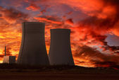 Nuclear power plant with an intense red sky — Stock Photo