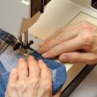 Working on a sewing machine — Stock Photo