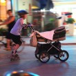 Person with a stroller — Stock Photo