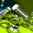 Bolt and nut, green background — Stock Photo