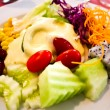 Salad from fruit and vegetables on white plate — Stock Photo