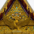The elongated and elaborately carved apex of the gable of a Buddha — Стоковая фотография