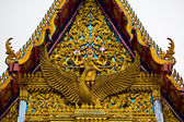The elongated and elaborately carved apex of the gable of a Buddha — Stock Photo