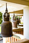 Old bells in a buddhist temple of Thailand — Stock Photo