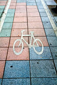 This is a bicycle way sign in footpath — Stock Photo