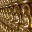 Many image of buddha on wall - Stockfoto