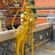 Стоковое фото: Kinaree, mythology figure, is watching temple in Grand