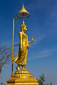 Golden buddha image with blue sky — Stock Photo