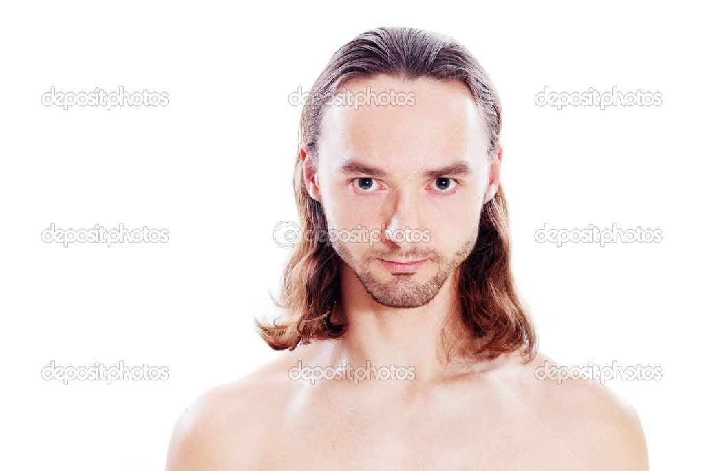 Confident young man with long hair and bristle  Stock Photo #4700127