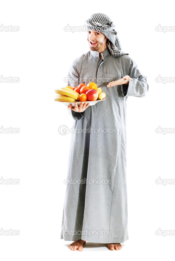 Young bedouin man in traditional dress with fruit — Stock Photo #4848461