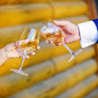Royalty-Free Stock Photo: Champagne glasses in hands