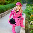 Pretty girl dressed in pink clothes — Stock Photo