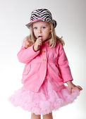Beautiful sweet toddler girl in pettiskirt and zebra hat — Stock Photo