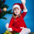 Stock Photo: Joyful little girl in Santa costume