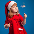 Cute little miss santa playing with Bengal fire — Stock Photo