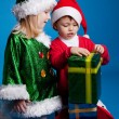 Stock Photo: Girl and boy in Christmas costumes