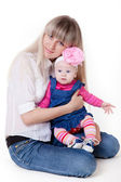 Pretty young mother with angelic baby girl — Стоковое фото