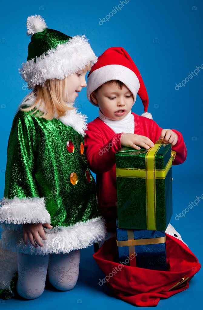 Girl and boy in Christmas costumes — Stock Photo #4459948