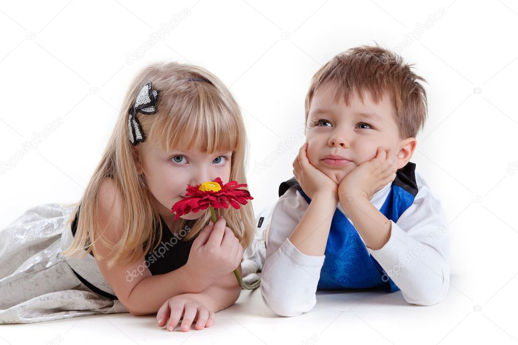 Adorable boy and the girl smelling a flower — Stock Photo #4459979