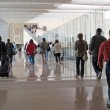 Airport moving crowd — Stock Photo