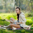 Young girl with book in hands — Stockfoto #4211792