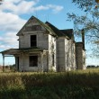 Run Down Farmhouse - Stock Photo