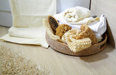 Towels and sponge in a basket — Stock Photo
