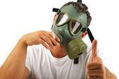 Gas mask man smoking — Stock Photo
