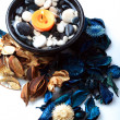 Orange candle with potpourri — Stock Photo